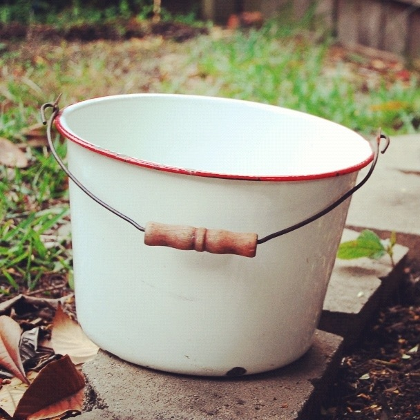 red and white enamelware bucket